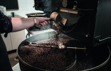Coffee beans poured from the roaster to the cooler - Copenhagen Coffee Lab - Kalles Kaffe